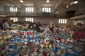 Volunteers sorting donated tinned food which will be distributed to low-income families for Thanksgiving. The annual food distribution is organized by Lighthouse of Oakland County, a social services a... - Jim West - 18-11-2011