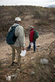 Volunteers with No More Deaths, carrying food and water as they patrol desert trails. The faith based groups goal is to reduce the death toll among Mexican migrants who cross the desert to find work i... - Jim West - 2010s,2012,aid,America,american,american USA,americans,americas,Arizona,assistance,border,border control,border controls,border crossing,borders,bottle bottles,bottled,carries,carry,carrying,charitabl