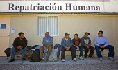 Men deported from the United States waiting at an aid station run by Grupos Beta, a Mexican government agency that assists deportees. They will get medical attention, if needed, shelter for a few days... - Jim West - 31-01-2012