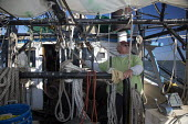 Mobile, Alabama - A shrimp trawler on Mobile Bay. Capt. Sid Schwarz operates a winch to lower a net. The trawler is part of the Alabama Fisheries Cooperative. - Jim West - 08-11-2012