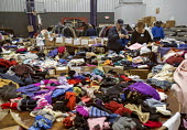 Manahawkin, New Jersey - Volunteers at the King of Kings Church sort donated clothing for people displaced by Hurricane Sandy. The church filled its sanctuary with food and its gym with clothing for s... - Jim West - &,2010s,2012,African American,African Americans,America,apparel,BAME,BAMEs,belief,black,BME,bmes,charitable,charity,christian,christianity,christians,church,churches,clothes,clothing,conviction,DIA,di
