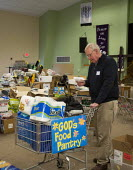 Manahawkin, New Jersey - Gods Food Pantry, Volunteers at the King of Kings Church sort donated food and cleaning supplies for people displaced by Hurricane Sandy. The church filled its sanctuary with... - Jim West - 27-11-2012