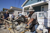 New Orleans, Louisiana - Volunteers help build a house for a low-income family through Habitat for Humanity. Many homes in the city are still in need of repair or rebuilding seven years after Hurrican... - Jim West - American,2010s,2012,America,American,americans,building,buildings,charitable,charity,circular,construction,developer,developers,development,DIA,employee,employees,Employment,families,family,for,giving