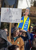 Hyattsville, Maryland USA - Slave at Walmart. Walmart workers, some of them on strike, rally with supporters outside one of the companys stores on Black Friday, demanding better pay, regular hours, af... - Jim West - 23-11-2012