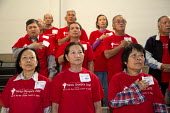 New Orleans, Louisiana - Senior citizens listen to the U.S. national anthem before the beginning of the VIET Senior Olympics, a day of both active and sedentary games. The event was organized by Vietn... - Jim West - 03-11-2012