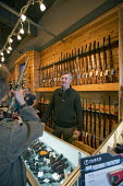 Milford, Michigan - Customers crowded the Huron Valley Guns store on Gun Appreciation Day. Pro-gun groups gathered at gun stores across the nation to buy weapons and to oppose proposed limits on gun o... - Jim West - 19-01-2013