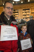 Milford, Michigan - 2nd amendment is to protect American Liberty over tyranical Govenment, a father and son with placards in the Huron Valley Guns store on Gun Appreciation Day. Pro-gun groups gathere... - Jim West - 2010s,2013,2nd,activist,activists,amendment,America,American,americans,Appreciation,armed,arms,bought,boy,boys,buy,buyer,buyers,buying,CAMPAIGN,campaigner,campaigners,CAMPAIGNING,CAMPAIGNS,change,chan