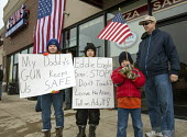 Milford, Michigan - A farther and his children were among those who crowded the Huron Valley Guns store on Gun Appreciation Day. Pro-gun groups gathered at gun stores across the nation to buy weapons... - Jim West - 19-01-2013