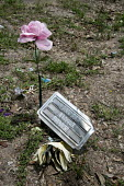 Falfurrias, Texas USA. Unknown female remains. Graves in Sacred Heart Cemetery where the remains of unidentified migrants who dies crossing the border are buried. Dozens of migrants without legal pape... - Jim West - 2010s,2013,aluminium,America,americans,Belief,border,border borders,border control,border controls,borders,Brooks County,burial,buried,cemeteries,cemetery,Cemetery Cemeteries,checkpoint,cross,cross cr