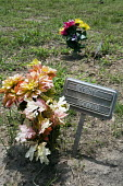 Falfurrias, Texas - Unknown remains. Graves in Sacred Heart Cemetery where the remains of unidentified migrants who dies crossing the border are buried. Dozens of migrants without legal papers die eac... - Jim West - 21-07-2013