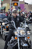 Detroit, Michigan - A motorcycle rider in the annual Cinco de Mayo parade in the Mexican-American neighborhood of southwest Detroit. He is a member of Hogs in Ministry, a group of Christian bikers. - Jim West - 04-05-2014