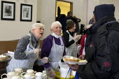 Detroit, Michigan - Volunteers serve a meal to the homeless and low-income individuals at the Open Door Ministry, a project of Fort Street Presbyterian Church. - Jim West - 23-01-2014