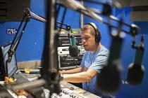 Immokalee, Florida - Gerardo Reyes Cha¡vez broadcasts on Radio Conciencia (aka La Tuya), a low power community radio station operated by the Coalition of Immokalee Workers (CIW). The Coalition seeks... - Jim West - 14-02-2014