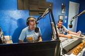 Immokalee, Florida Gerardo Reyes Chavez broadcasts on Radio Conciencia (aka La Tuya), a low power community radio station operated by the Coalition of Immokalee Workers (CIW). His guest is Cesar Gonza... - David Bacon - 14-02-2014