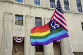 Detroit, Michigan - A flag supporting marriage equality flies during a rally at the Federal Courthouse as a judge was hearing arguments on the constitutionality of Michigan's ban on same-sex marriage... - Jim West - American,2010s,2013,activist,activists,America,American,americans,campaign,campaigner,campaigners,campaigning,CAMPAIGNS,civil rights,color,colorful,colorfull,colors,colour,colourful,colours,court,cour