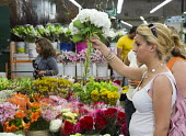Los Angeles - A shopper in Los Angeles flower market. Most flowers sold in the market are imported. - Jim West - American,2010s,2012,America,American,americans,Angeles,bought,buy,buyer,buyers,buying,California,cities,city,commerce,commodities,commodity,consumer,consumers,customer,customers,cut,district,EBF,Econo