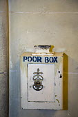 Los Angeles, California - The Poor box at St. Vincent de Paul Roman Catholic Church. Small change is saved for those in poverty. - Jim West - 16-06-2012