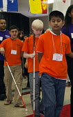 Los Angeles, California - Blind students arrive at the start of the National Braille Challenge, a competition that tests their ability to transcribe, type, and read braille using a typewriter-like Per... - Jim West - American,2010s,2012,America,American,americans,Angeles,asian,asians,BAME,BAMEs,black,blind,BME,bmes,boy,boys,braille,California,cane,Challenge,child,CHILDHOOD,children,compete,COMPETITATIVE,competitio