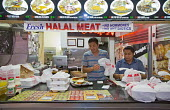 Los Angeles, California - Workers prepare take-away meals at a food stand that sells halal meat - Jim West - American,2010s,2012,America,American,americans,Angeles,asian,asians,away,BAME,BAMEs,Black,BME,bmes,BREAK,California,capitalism,capitalist,catering,chef,chefs,cook,COOKERY,cooking,cooks,court,Diaspora,
