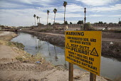 Calexico, California, The heavily-polluted New River as it enters the USA from Mexico. The pollution results from a mix of untreated sewage, agricultural runoff, and industrial waste. A U.S. Border Pa... - Jim West - 27-01-2012