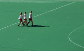 Chula Vista, California - Three female athletes leave the field hockey training facility at the U.S. Olympic Training Center. - Jim West - American,2010s,2012,adolescence,adolescent,adolescents,America,American,americans,athlete,athletes,athletics,California,Center,Chula,Committee,COMMITTEES,Diego,female,females,field,game,games,girl,gir