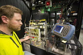 Batavia, Illinois - Chip Edstrom adjusts a laser at the New Muon Lab at the Fermi National Accelerator Laboratory. Fermilab scientists conduct basic research into the smallest elements of matter. The... - Jim West - 05-11-2013