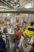 Batavia, Illinois - Cryotechnician Mike Beard runs equipment that provides liquid helium in the New Muon Lab at the Fermi National Accelerator Laboratory. Fermilab scientists conduct basic research in... - Jim West - 05-11-2013