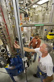 Batavia, Illinois - Cryotechnicians Joe Brown (white shirt) and Mike Beard run equipment that provides liquid helium in the New Muon Lab at the Fermi National Accelerator Laboratory. Fermilab scientis... - Jim West - 05-11-2013