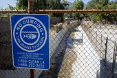 Sylmar, California - A sign warns against illegal dumping in a canal that drains storm water to the Pacific Ocean. - Jim West - 23-06-2012