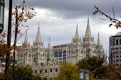 Salt Lake City, Utah - The Salt Lake Temple of the Church of Jesus Christ of Latter Day Saints (Mormons), next to Zions Bank. Zions Bank was started by church president Brigham Young in 1873 it is now... - Jim West - 14-11-2014