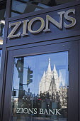 Salt Lake City, Utah - Zions Bank with the Salt Lake Temple of the Church of Jesus Christ of Latter Day Saints (Mormons) reflected in the glass door. Salt Lake City, Utah - Jim West - 16-11-2014