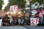 Detroit, Michigan - Fast food workers and supporters picket a McDonalds restaurant and block traffic on Mack Avenue, demanding a higher wage of 15 an hour. - Jim West - 04-09-2014