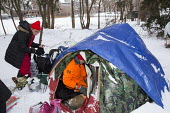 Detroit, Michigan - Joshua Messerschmidt (in tent), an unemployed carpenter, and Brittney Hines in a tent city that homeless people have established near downtown Detroit. About 2.5 percent of Detroit... - Jim West - 09-01-2015