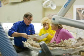 Salt Lake City, Utah - The Natural History Museum of Utah at the Rio Tinto Center on the University of Utah campus. A scientist in the Paleo Prep Lab shows visitors fossils that are being prepared for... - Jim West - 15-11-2014