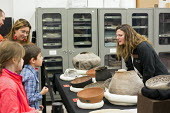 Salt Lake City, Utah. The Natural History Museum of Utah at the Rio Tinto Center on the University of Utah campus. An archaeologist shows visitors artefacts from the Glen Canyon Archaeological Recover... - Jim West - 15-11-2014