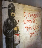 Detroit, Michigan - I remember when this was trees. A mural by the graffiti artist Banksy on display at the nonprofit 555 Gallery. The gallery removed the mural from the abandoned Packard automotive p... - Jim West - 04-05-2014