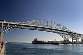 Port Huron, Michigan, The bulk freighter Wolverine passing under the Blue Water Bridge a twin span international bridge across the St. Clair River that links Port Huron, Michigan, USA, and Point Edwar... - Jim West - 27-09-2004