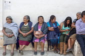 San Sebastian Abasolo, Oaxaca, Mexico - Women wait for mass to begin outside San Sebastian Abasolo Catholic church during the towns yearly celebration of San Sebastian, the towns patron saint. - Jim West - 15-01-2015