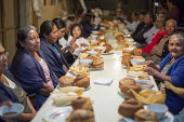 San Sebastian Abasolo, Oaxaca, Mexico - Residents of San Sebastian Abasolo share a meal during the yearly celebration of San Sebastian, their towns patron saint. During the nine-day celebration, mass... - Jim West - 15-01-2015