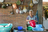 San Sebastian Abasolo, Oaxaca, Mexico - Women wash dishes at a home after a meal during the yearly celebration of San Sebastian. During the nine-day celebration, mass is held at the local church every... - Jim West - 15-01-2015