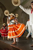 Oaxaca, Mexico - A folk dance group performs dances from eight regions of Oaxaca in the Guelaguetza Folk Dance show at the Hotel Quinta Real. - Jim West - 2010s,2015,ACE,americas,Amerindian,Amerindians,cities,city,communities,community,convent,costume,costumes,culture,dance,dancer,dancers,dancing,dinner,dinners,dressed up,dressing up,fancy dress,folk da