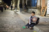 Oaxaca, Mexico - A seven year old boy plays the accordion and sings for money on the street. - Jim West - 13-01-2015
