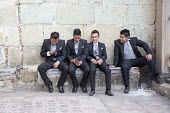 Oaxaca, Mexico - Teenage boys dressed formally outside San Felipe Neri Catholic church. - Jim West - 17-01-2015