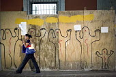 Oaxaca, Mexico - Hands Up, Dont Shoot graffiti on a construction site in solidarity with protests against the police killing of unarmed African-Americans in the United States. - Jim West - 17-01-2015