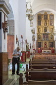 Oaxaca, Mexico - A man mops the floor at San Agustin Catholic church. - Jim West - 20-01-2015