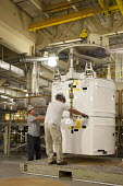 Carlsbad, New Mexico - Workers prepare transuranic nuclear waste from America's nuclear weapons program for long-term storage at the Waste Isolation Pilot Plant. The materials are stored in rooms carv... - Jim West - 11-10-2010
