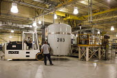 Carlsbad, New Mexico - Workers prepare transuranic nuclear waste from Americas nuclear weapons program for long-term storage at the Waste Isolation Pilot Plant. Here a fork lift brings a TRUPACT shipp... - Jim West - 11-10-2010