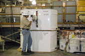 Carlsbad, New Mexico - Workers prepare transuranic nuclear waste from America's nuclear weapons program for long-term storage at the Waste Isolation Pilot Plant. Here a worker checks radiation levels... - Jim West - 11-10-2010