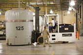Carlsbad, New Mexico - Workers prepare transuranic nuclear waste from Americas nuclear weapons program for long-term storage at the Waste Isolation Pilot Plant. The materials are stored in rooms carve... - Jim West - 11-10-2010