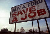 Dearborn, Michigan - Buy a Ford Save a Job. A sign put up by the UAW Local 600, which represents workers at the Ford River Rouge plant (background) urges Buy a Ford. Save a Job. - Jim West - American,1990s,1992,AFL CIO,AFL–CIO,AFL-CIO,America,American,americans,AUTO,auto industry,AUTOMOBILE,AUTOMOBILES,Automotive,buy,buyer,buyers,BUYING,capitalism,capitalist,car,Car Industry,carindustry